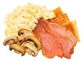 Scrambled eggs and bacon freshly cooked rashers with fried bread mushrooms isolated on a white background Royalty Free Stock Photography