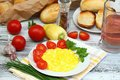 Scrambled eggs, baguettes  and vegetable Royalty Free Stock Photo