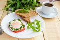Scrambled eggs, baked in a ring bell pepper, toast, arugula leaves and a cup of coffee. Royalty Free Stock Photo