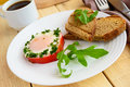 Scrambled eggs, baked in a ring bell pepper, toast, arugula Royalty Free Stock Photo