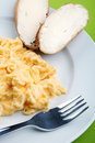 Scrambled eggs and bread with butter Royalty Free Stock Photo