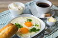 scrambled eggs, bread, butter, coffee for Breakfast. Royalty Free Stock Photo