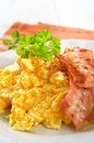 Scrambled eggs fried bacon Stock Image