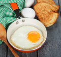 Scrambled eggs in a pan on a gray background Royalty Free Stock Photo