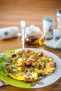 Scrambled eggs and sausages cauliflower with dill on a wooden table Stock Photo