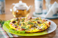 Scrambled eggs and sausages cauliflower with dill on a wooden table Royalty Free Stock Image