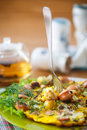 Scrambled eggs and sausages cauliflower with dill on a wooden table Royalty Free Stock Photos