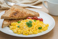 Scrambled eggs and toast on a plate and coffee cup Royalty Free Stock Photo