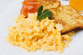 Scrambled eggs with toasted bread Royalty Free Stock Photography