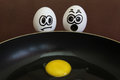 Scrambled eggs two look at the third in a frying pan Royalty Free Stock Photo