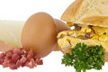 Scrampled eggs and raw ingredients on a roll Stock Photography