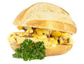 Scrampled eggs and raw ingredients on a roll Royalty Free Stock Photo