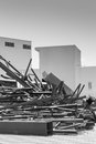 Scrap metal and junk with white buildings in the background Stock Photos