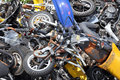 Scrap motorcycles pile of scrapped seized by the police waiting to be crushed Stock Photos