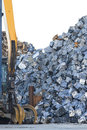 Scrap yard with grab and crushed cars crane into small cubes Stock Image