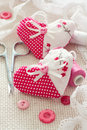 Scrapbook set for valentines day selective focus hearts spools of thread buttons laces over canvas background Royalty Free Stock Photos