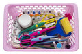 Scrapbooking tools in pink plastic basket Royalty Free Stock Photo