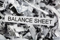 Scraps balance sheet shredded paper tagged with symbol photo for data destruction budgets and accounting Royalty Free Stock Images