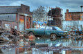 Scrapyard england showing flood water and old car worcestershire Royalty Free Stock Photography