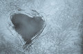 Scratched heart on frosty window shape pattern the Stock Image