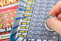 Scratching lottery ticket Royalty Free Stock Photo