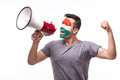 Scream on megaphone hungarian football fan in game supporting of hungary national team white background european fans Stock Photo