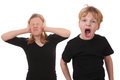 Scream screaming young boy and girl covering her ears Stock Photos