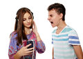 Scream to be heard teenage boy trying make himself his girlfriend listening music on headphones Stock Images