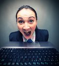 Scream young caucasian businesswoman screaming behind laptop Royalty Free Stock Images