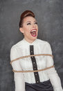 Screaming business woman tied with rope Royalty Free Stock Photo