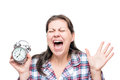 Screaming crazy woman with an alarm clock in her hands Royalty Free Stock Photo