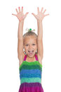 Screaming girl with her ​​hands raised Royalty Free Stock Photo