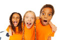 Screaming happy soccer team kids
