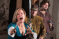 Screaming mad middle ages female dagger friends Stock Photo