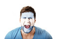 Screaming man with Argentina flag on face. Royalty Free Stock Photo