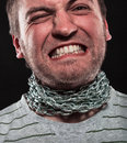 Screaming man iron chain around neck Stock Photo