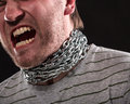 Screaming man with iron chain around neck Stock Images