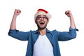 Screaming man in santa hat is winning with hands the air on white background Stock Images