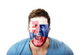 Screaming man with Slovakia flag on face.