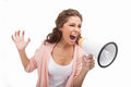 Screaming into megaphone angry young woman at Royalty Free Stock Photos