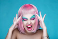 Screaming Sexy Girl with Creative Makeup and Pink Hairs touch he Royalty Free Stock Photo
