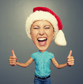 Screaming woman in santa hat funny picture of Royalty Free Stock Photography