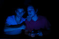 Screem gaming two friends in front of a computer screen Royalty Free Stock Images