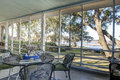 Screen porch with waterfront view Royalty Free Stock Photo