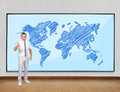 Screen with world map businessman showing thumb up and Royalty Free Stock Image