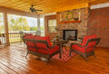 Screened backyard deck with fireplace overlooking lake Stock Photo