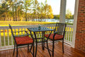 Screened backyard deck patio with furniture overlooking lake Royalty Free Stock Photo