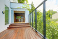 Screened walkout deck with wooden floor Stock Image