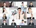 Screenshot of smiling business group online brainstorm on video conference Royalty Free Stock Photo