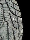 Screw in tire into rubber isolated towards black background Stock Photo